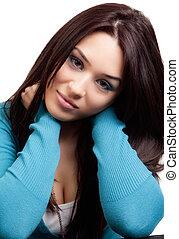 Studio portrait of one cute brunette woman