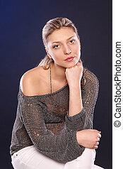 Studio portrait of pensive woman