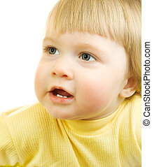 Studio portrait of small smiling girl in yellow