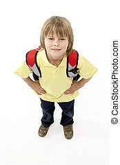Studio Portrait of Smiling Boy Holding Ruck Sack