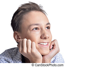 Studio portrait of smiling teenage boy on white background