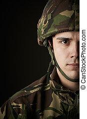 Studio Portrait Of Soldier In Uniform