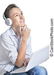 Studio portrait of teenage boy on white background