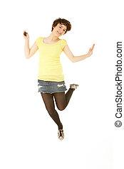 Studio Portrait Of Teenage Girl Jumping In Air