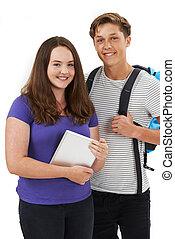 Studio Portrait Of Teenage Student Couple