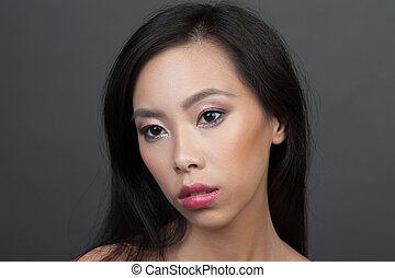Studio portrait of young asian woman