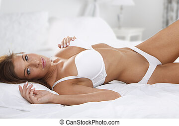 young beautiful woman on bed