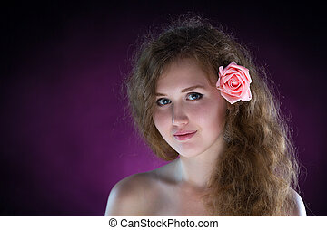 Studio portrait of young beautiful woman with roses in the smoke