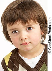 Studio Portrait Of Young Boy