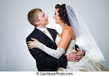 Studio portrait of young elegant enamored just married bride...