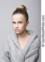 Studio Portrait of Young Female in Gray Woolen Cardigan