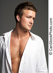 Studio Portrait Of Young Man Wearing Open Shirt
