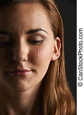 Studio Portrait Of Young Woman Crying