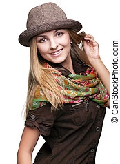 Studio portrait of young woman in hat