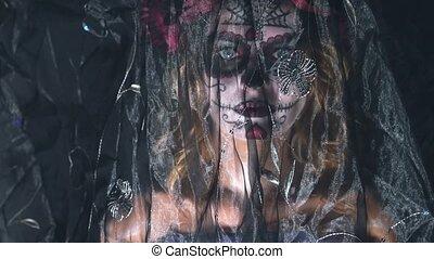 Studio portrait shoot Santa Muerte makeup woman on Halloween eve