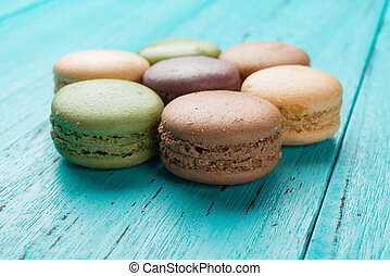 studio shoot of colorful macaroons on a blue background