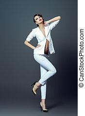 studio shot - Fashion shot of a beautiful model posing at...