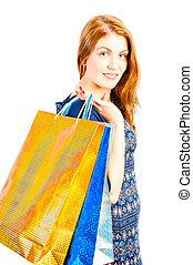studio shot of a beautiful girl shopaholic