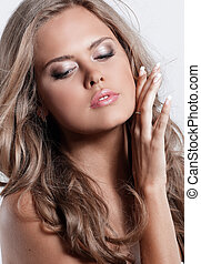Studio shot of a beautiful young woman with perfect skin against
