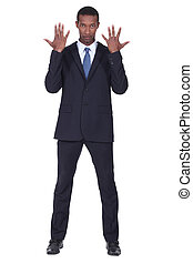 Studio shot of a business man with his hands in the air