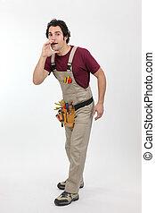 Studio shot of a handyman calling out