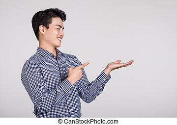 Studio shot of a man's hand pointing at something
