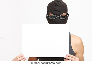 masked man with a message board