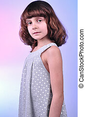 pretty 8 year old girl in silver dress - studio shot of a...