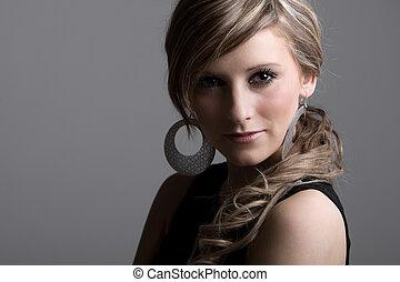 Studio Shot of a Pretty Teenage Girl against Grey Background