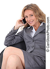 Studio shot of a woman with a cellphone