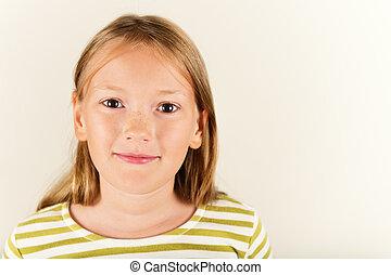 Studio shot of adorable little 9 year old girl