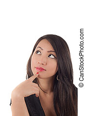 Studio shot of beautiful sexy young asian woman looking up wondering, isolated on white