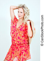 studio shot of beautiful woman in summer clothes