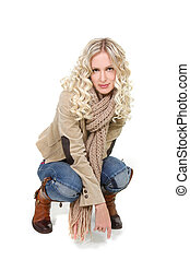 studio shot of beautiful woman in winter clothes