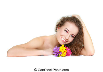 studio shot of beautiful woman with flowers