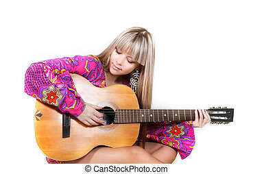 studio shot of beautiful woman with guitar