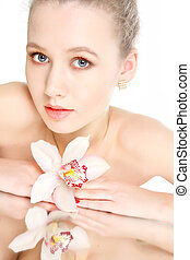 studio shot of beautiful woman with flower
