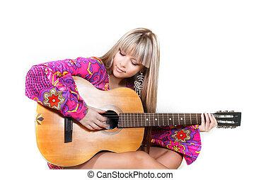 studio shot of beautiful woman with guitar