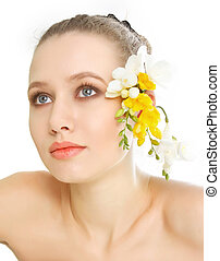 studio shot of beautiful woman with spring flowers over white