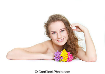 studio shot of beautiful young woman with flowers