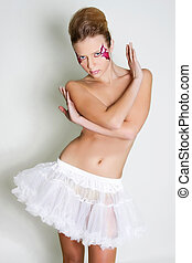 studio shot of beautiful young woman with bright face art visage