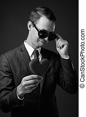 Studio shot of businessman against gray background