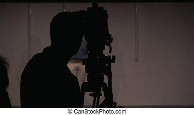 Studio shot of cameraman - Studio shot of young man with...