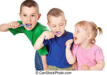 children to brush his teeth - studio shot of children to...