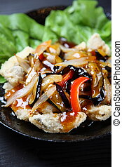 Chinese fish with vegetables sauce on top