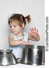 studio shot of cooking child