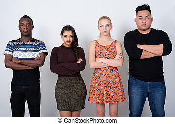 Studio shot of diverse group of multi ethnic friends with arms c