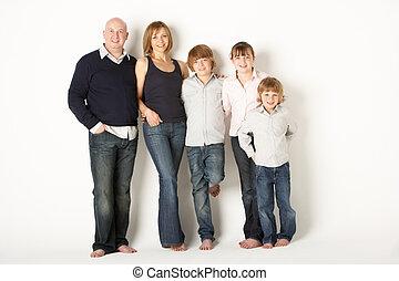 Studio Shot Of Family Group Standing In Studio