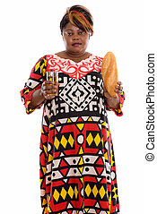Studio shot of fat black African woman standing while...