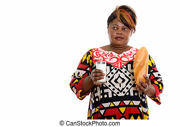 Studio shot of fat black African woman thinking while...